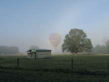 Balloon Flight through morning mist
